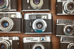 Retro styled image of old photo cameras on a flee market Royalty Free Stock Image