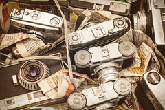 Retro styled image of old photo cameras on a flee market Stock Photo