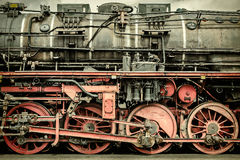 Retro styled image of an old steam locomotive royalty free stock photography