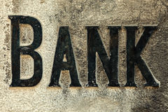 Retro styled image of an old stone bank sign Stock Photos