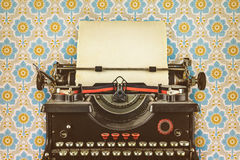 Retro styled image of an old typewriter stock photo