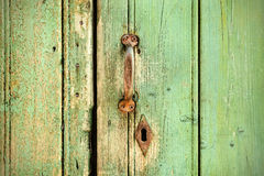 Retro styled image of an old wooden door Royalty Free Stock Images