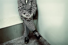 Retro styled image of a prisoner inside a prison Royalty Free Stock Photography