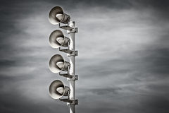 Retro styled image of a row of megaphones Stock Images