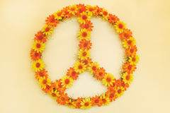 Retro styled image of a seventies flower power peace sign. Made out of flowers Stock Photography