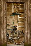 Retro styled image of a shed with a bicycle inside Stock Photos