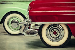 Retro styled image of two vintage American cars Royalty Free Stock Photos