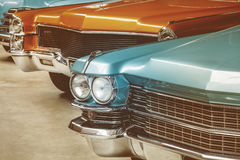 Retro styled image of vintage American cars Stock Photos