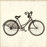 Retro styled image of a vintage lady bicycle royalty free stock photography