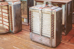 Retro styled image of vintage small wall jukeboxes on a flee mar Stock Photography