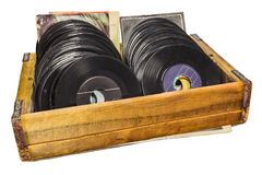 Retro styled image of a wooden box with vinyl lp records Royalty Free Stock Image