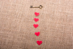 Retro styled  key and heart shapes objects Royalty Free Stock Photo
