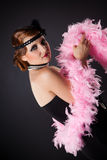 Retro-styled lady with pink necklet. Studio isolated shot Stock Images
