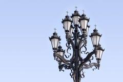 Retro styled lighting lantern over blue sky Stock Images