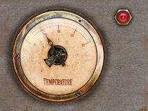 Retro styled metal gauge. Steampunk themed vintage brass and copper gauge with red lamp on metal background Stock Photos