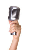 Retro styled microphone in hand Stock Photo