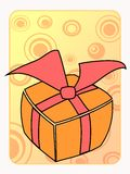 Retro styled orange birthday gift. With a bow on a yellow background Stock Images