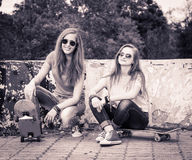 Retro styled portrait of teenagers near urban wall. Vintage imag Royalty Free Stock Photos