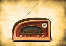 Retro styled radio on grunge background Stock Photos