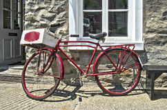 Retro styled red bicycle. Retro styled image of a vintage  red bicycle with wooden crate Royalty Free Stock Photography