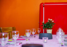 Retro-styled red refrigerator in the kitchen room Royalty Free Stock Images