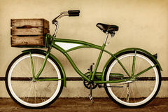 Retro styled sepia image of a vintage bicycle with wooden crate. Retro styled sepia image of a vintage beach cruiser bicycle with wooden crate Royalty Free Stock Photo