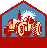 Retro styled tractor with farmer Royalty Free Stock Photos