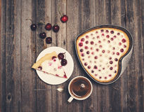 Retro styled vintage background. Slice of homemade cherry pie an Royalty Free Stock Photography