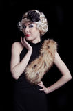 Retro-styled woman with boa royalty free stock images