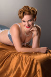 Retro  styled woman with fifties hair & makeup in lingerie Stock Image