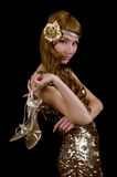 Retro-styled woman in golden dress stock image