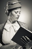 Retro Styled Woman Reading A Book Royalty Free Stock Photography