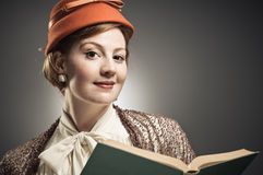 Retro Styled Woman Reading A Book Royalty Free Stock Image