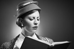 Retro Styled Woman Reading A Book Royalty Free Stock Images