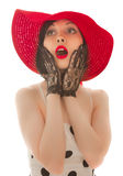 Retro-styled woman in red hat. Surprised isolated on white background Stock Images