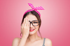 Retro styled young asian woman covers her eyes with one hand. Stock Photo