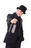 Retro stylish man in black suit with bottle of drink Stock Photos