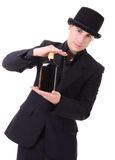 Retro stylish man in black suit with bottle of drink Royalty Free Stock Images