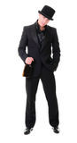 Retro stylish man in black suit with bottle of drink Stock Images