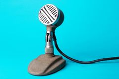 Retro stylish microphone. On a blue background royalty free stock photography