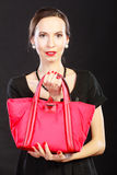Retro stylish woman with red handbag Stock Photography