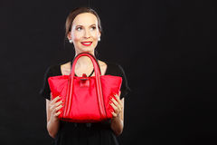 Retro stylish woman with red handbag Stock Image