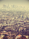 Retro stylized aerial view of Los Angeles seen through smog, USA.  Stock Image