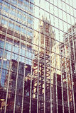 Retro stylized buildings reflection in windows, Manhattan, NYC, Royalty Free Stock Images