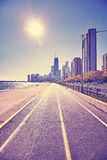 Retro stylized Chicago waterfront against sun with lens flare Stock Photo