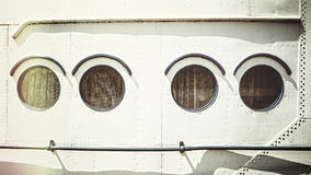 Retro stylized close up picture of an old ship portholes Stock Photo