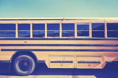 Retro stylized close up picture of a school bus side Royalty Free Stock Photo