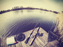 Retro stylized fisheye lens picture of fishing tackle. Stock Photos