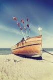 Retro stylized fishing boat on a beach Stock Photo