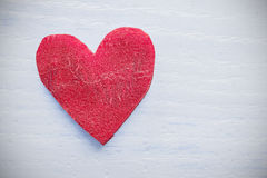 Retro stylized heart made of beet on grunge background. Royalty Free Stock Photography